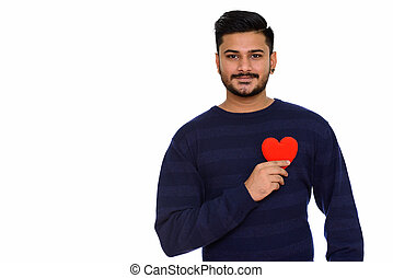 Young handsome Indian man ready for Valentine's day holding red
