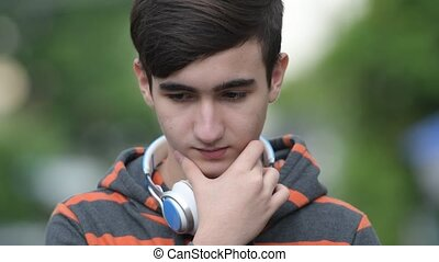 Young handsome Iranian teenage boy in the streets outdoors