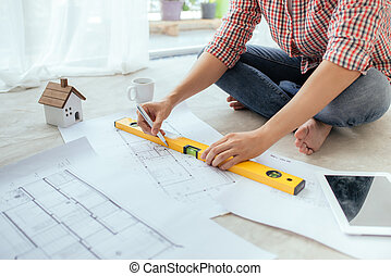 Young handsome male asian architect working at home on the...