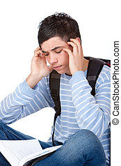 Young handsome male student having headache from learn stress