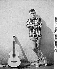 Young handsome man and guitar