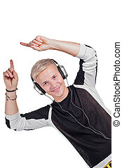 Young handsome man dancing with headphones