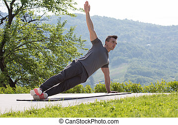 man doing morning yoga exercises