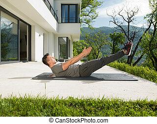 man doing morning yoga exercises