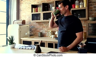 handsome man drinking a coffee