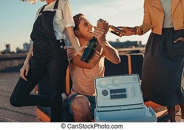 man giving beer to women