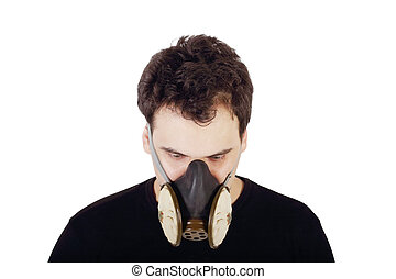 Young handsome man in black shirt and respirator looks down