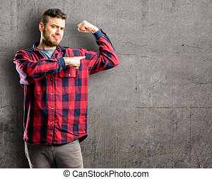 pointing biceps expressing strength and gym concept, healthy life its good