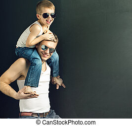 Young handsome man posing with his son