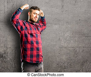 showing biceps expressing strength and gym concept, healthy life its good