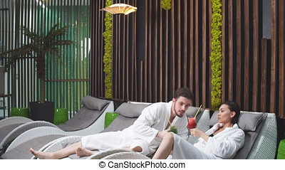 Young handsome man taking a rest with his wife in the spa center. Woman and man caring of their health.