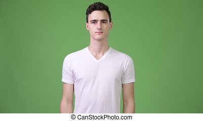 Young handsome man with arms crossed