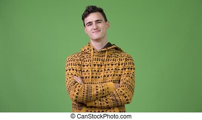 Young handsome man with arms crossed - Studio shot of young...