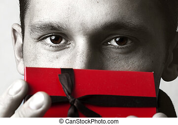 young handsome man with red christmas gift - Portrait of...