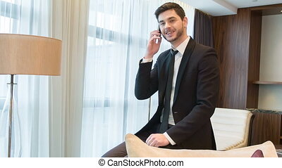 Young handsome men talking over phone