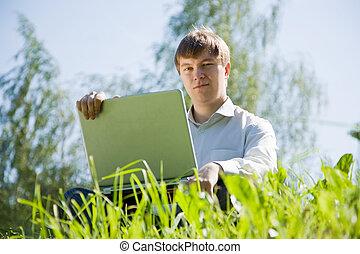 men working on laptop