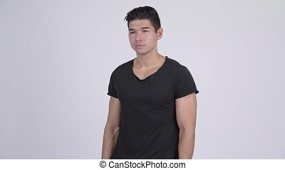 Young handsome multi-ethnic man thinking - Studio shot of...