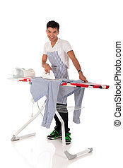 Young handsome Nepalese man, ironing