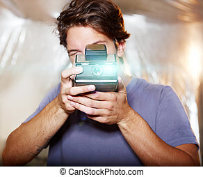 Young handsome photographer