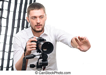 Young handsome photographer while giving directions