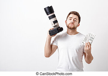 young handsome photographer with beard in shirt holding camera a