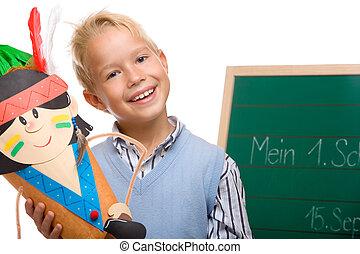 Young handsome schoolchild has first schoolday
