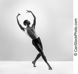 Young, handsome, sporty and athletic ballet dance. Black and...