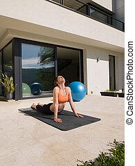 woman doing morning yoga exercises