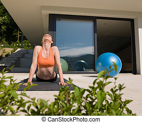 woman doing morning yoga exercises