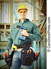 Worker man with a drill.