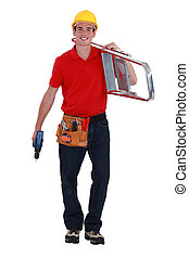 Young handyman with a ladder and drill