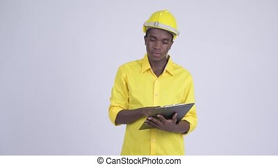 Young happy African businessman as engineer directing while...