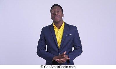 Young happy African businessman explaining something