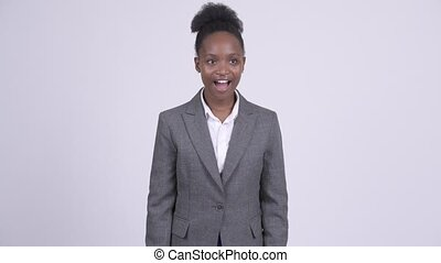 Young happy African businesswoman getting good news - Studio...