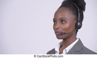 Young happy African businesswoman working as call center...