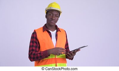 Young happy African man construction worker holding...