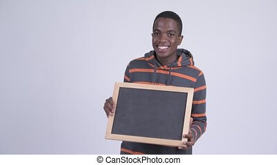 Young happy African man holding blackboard