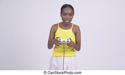 Young happy African woman playing games and winning