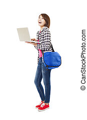 Young happy asian student with laptop and isolated on white