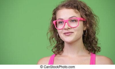Young happy beautiful nerd woman smiling with eyeglasses