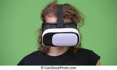 Young happy beautiful nerd woman using virtual reality headset