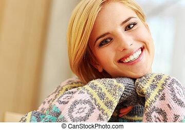 Young happy beautiful woman looking at camera