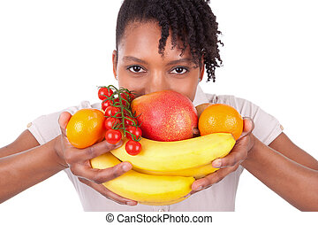 Young happy black / african american woman holding fresh fruits