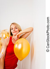 Young happy blonde woman with baloons smiling close up, lifestyle real people concept