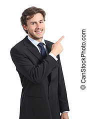 Young happy business man pointing at side