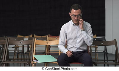 Young happy business man talking on a cell phone