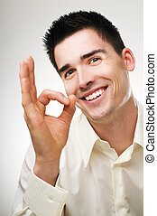 ok - young happy business men showing ok sign