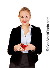 Young happy business woman holding red wallet