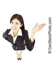 young happy business woman showing something