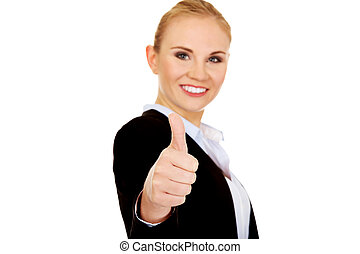 Young happy business woman shows thumb up